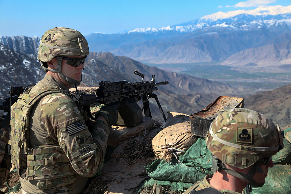 U.S. Army Sgt. Curtis Smith, left, provides security during an Afghan Border Patrol outpost assessment at the Nawa Pass in AfghanistanÂ's Kunar province, Feb. 10, 2013. Smith is assigned to the 101st Airborne Division's Security Force Advise and Assist Team Gambit, 2nd Battalion, 327th Infantry Regiment, 1st Brigade Combat Team. U.S. Army photo by Spc. Ryan Hallgarth